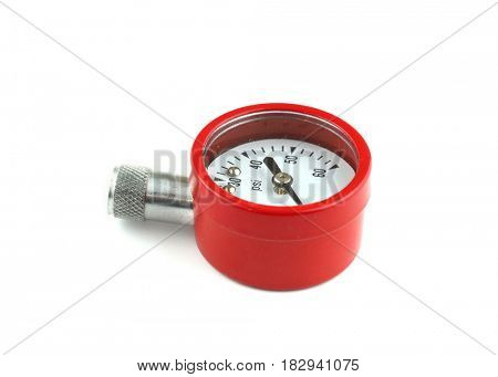 Red pressure checking gauge on white background