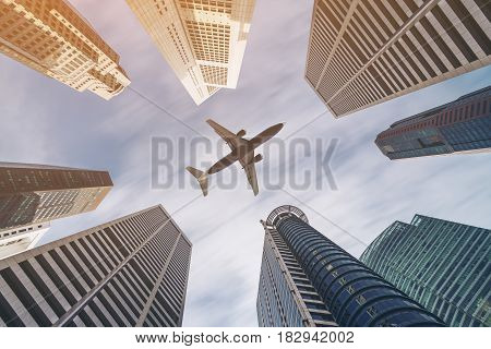 Airplane Flying Over City Business Buildings, High-rise Skyscrapers
