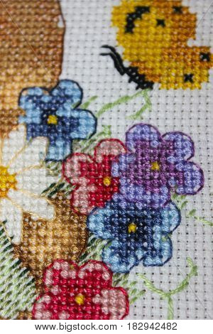 Cross stitch bright flowers and yellow butterfly