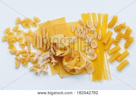 Italian Foods Concept And Menu Design. Assorted Types Of Pasta Farfalle, Pasta A Riso, Orecchiette P