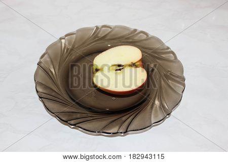 Half of an apple on a plate