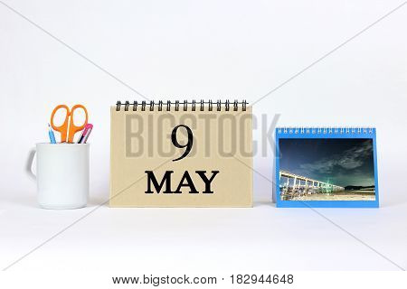 Deadline 9 May Calendar With White Background and Office.