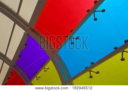 Red green yellow blue purple color glass windows of background