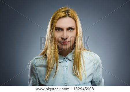 Portrait of angry woman isolated on gray background. Negative human emotion, facial expression. Closeup.
