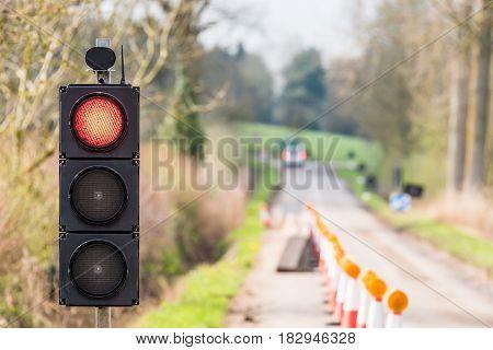 UK Motorway Roadworks Red Traffic Lights Cones.