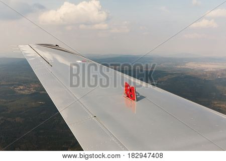 Exhaust brake pads on the wing small private aircraft. Airplace landing with extended brake pads on the wing