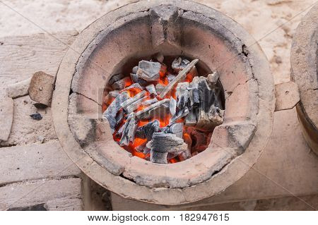 Thai stove, cooking tool. Traditional charcoal burning clay stove in a rustic wooden house.