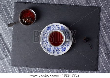 Cup for tea located on a black board top view