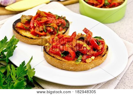 Bruschetta With Tomatoes And Peppers In Plate On Table