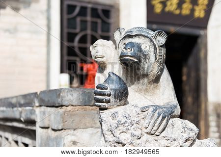 Shanxi, China -  Sept 05 2015: Monkey Statue At Wang Family Courtyard. A Famous Historic Site In Lin
