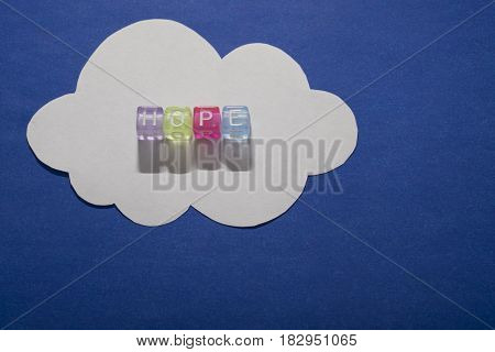 HOPE, by colorful alphabet beads and white paper cloud