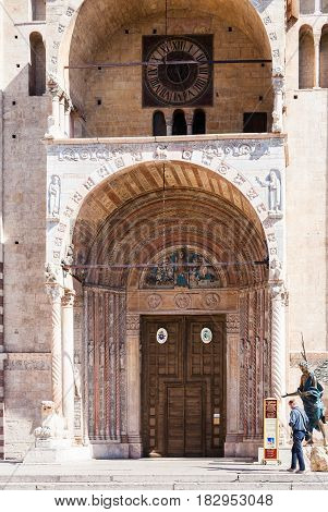 Visitor Near Doors Of Duomo Cathedral In Verona