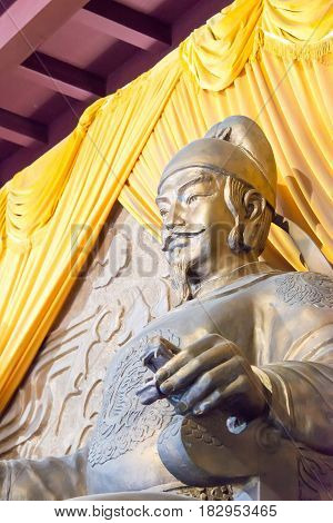 Sichuan, China - Mar 29 2015: Statue Of Emperor Gaozong At Huangze Temple. A Famous Historic Site In