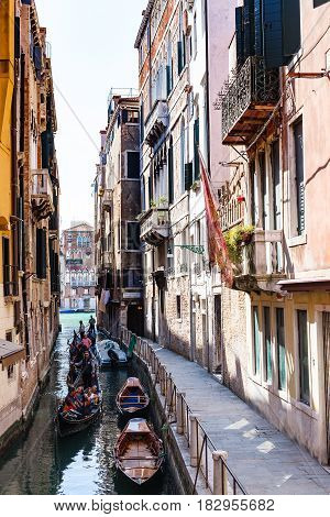 Tourists In Gondolas Little Canal In Venice City