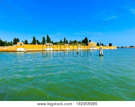 Venice lagoon with San Michele cemetery at sunny day at Italy.