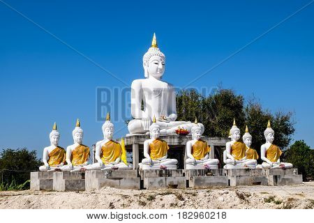 a lot of White Buddha with blue sky background