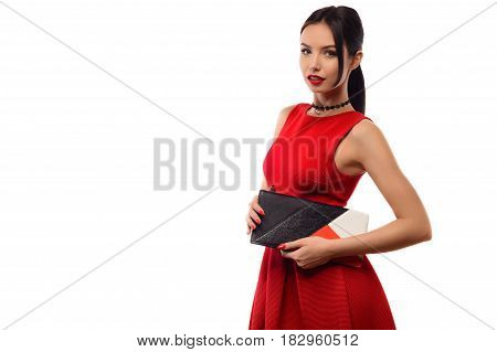Beautiful Stylish Brunette Girl In Red Dress Holds A Clutch In Hands