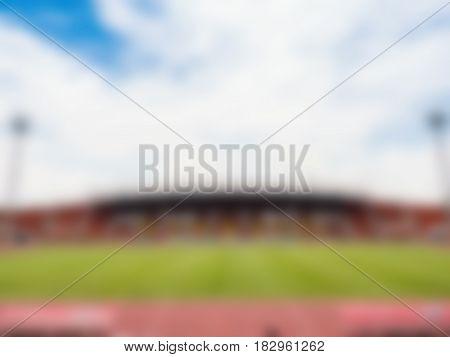 empty stadium with green field blurred background