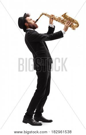 Full length profile shot of a man playing on a saxophone isolated on white background