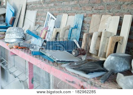 Construction in plastering and terrazzo job, Tools for cement work.