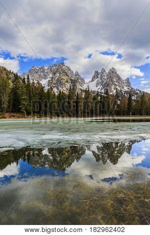 Spring view at Lago Antorno, Dolomites, Lake mountain landcape with Alps peak reflection, Misurina, Cortina d'Ampezzo, Italy