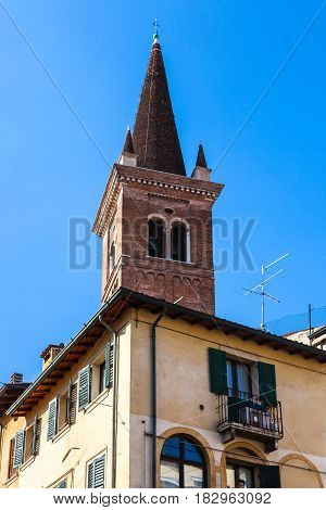 Tower Of Chiesa Di San Tomaso Becket Over House