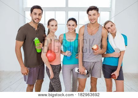 Young active group of people standing after workout together healthy lifestyle