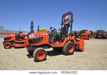 OAK RIDGE, LOUISIANA, April 8, 2107: The orange  utility and mowers tractors are products of Kubota Corporation, a tractor and heavy equipment manufacturer based in Osaka, Japan, established in 1890.