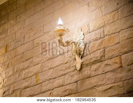 Lighting with crystal decorative on the brick wall.