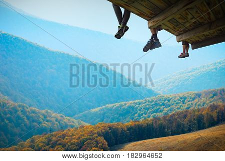 Tourists Sit On A Wooden Flooring