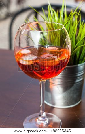 Glass Of Spritz Cocktail With Ice On Table