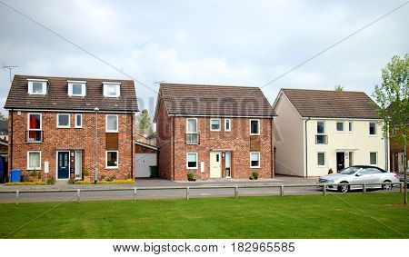 Bracknell, England - April 12, 2017: Three detached houses in a row on a modern housing estate in Bracknell, England.