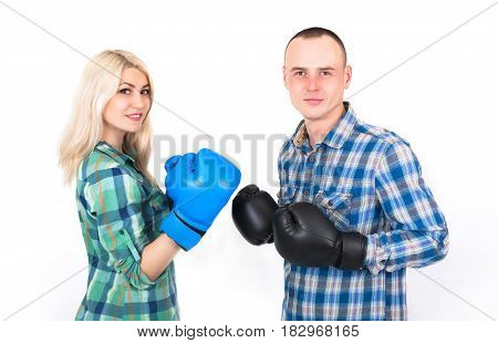 Studio shot of a beautiful funny couple expressive fighting on a white background.