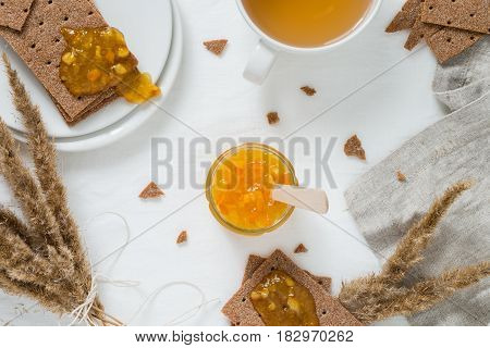 Sweet Snack Or Breakfast With Rye Crisp Bread (swedish Crackers), Spread Orange Jam, Cup With Green