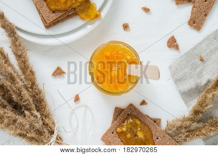 Sweet Snack Or Breakfast With Orange Jam In Glass Jar, Rye Crisp Bread (swedish Crackers) With Sprea