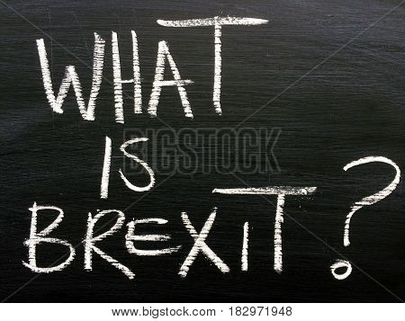 The question What Is Brexit? written by hand in white text on a blackboard