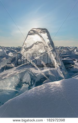 Transparent figured ice blocks in soft morning light