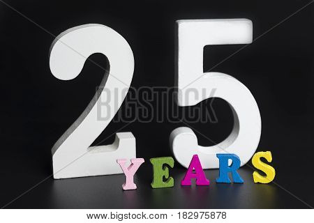 Letters and numbers for twenty-five years on a black isolated background.