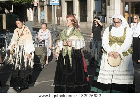VALLADOLID, SPAIN - JULY 25, 2016: Valladolid (Castilla y Leon Spain): religious procession of Santiago a young women with traditional costume