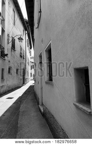 Typical street at Riva San Vitale (Ticino Switzerland) along the Lake of Lugano (Ceresio). Black and white
