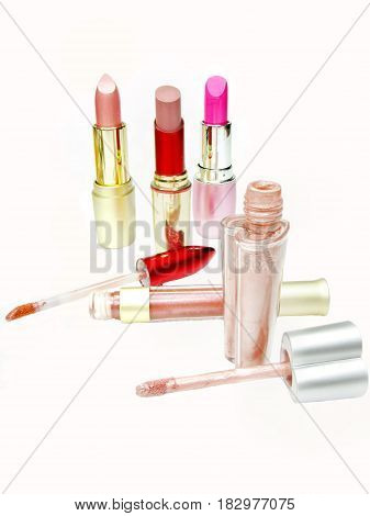 group of lipsticks and lip glosses women cosmetic set