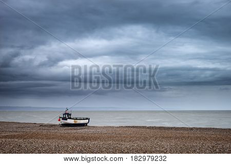 Abandoned Fishing Boats On Shingle Beach Landscape In Winter