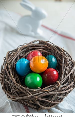 Colorful easter eggs in a wooden basket