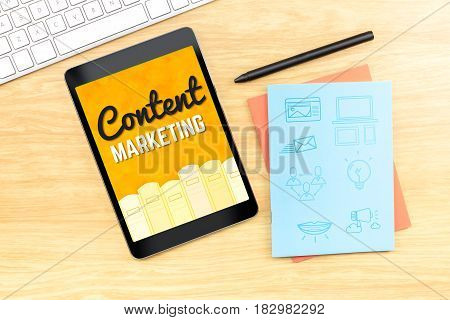 Content Marketing word on tablet screen with icon on blue notebook at wood table Digital Marketing concept.