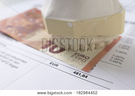 A gypsum dental impression on a banknote and dentistry