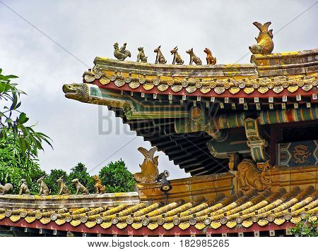 Colorful ornaments and sculptures on the roof of the Po Lin Monastery on Lantau Island in Hong Kong