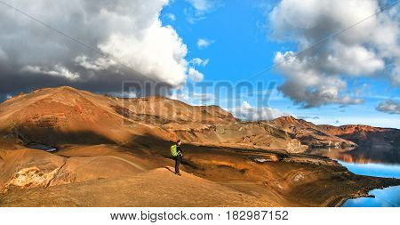 Panoramic View Of Beautiful Geothermal Landscape With Woman Standing On Mountain Top Near Askja Crat
