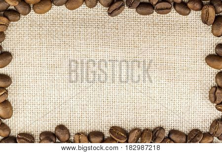 Burlap Sackcloth Canvas and Coffee Beans Placed Round in Circle Photo Background. Copy Space. Coffee Border