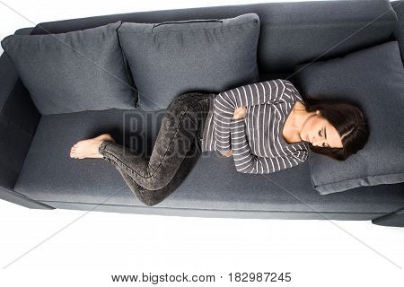 View From Above On Pills Pack In Hand Of Ill Young Woman Laying On Sofa