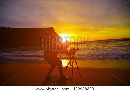 Silhouette Of A Young Man Using A Camera Sea Sunset